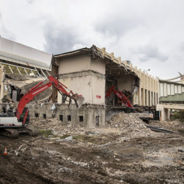 A demolition crew begins knocking down buildings at LACMA, a first step in the construction of its new campus, on April 7