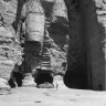 Tourist next to the Buddhas of Bamiyan in Afghanistan photo by Edmund Melzl in 1958