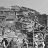 Men cleaning up ruins and reconstructing bombed buildings, Chongqing, China, 1941.